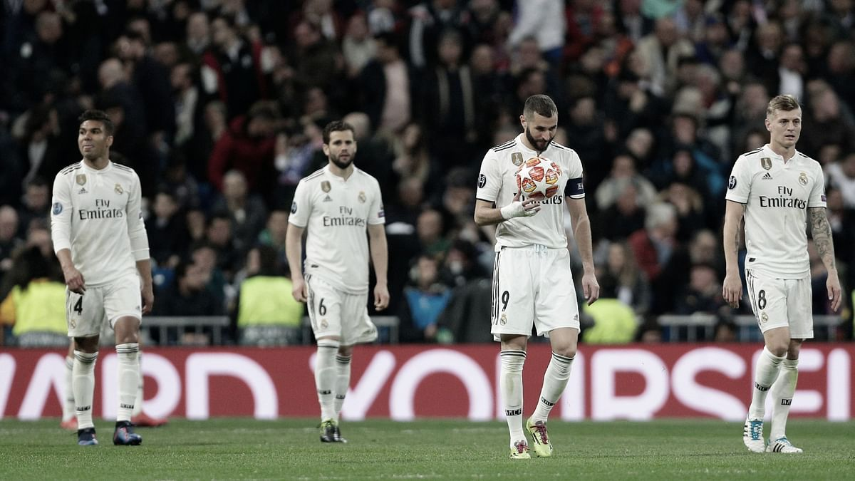 Down, and out: Real Madrid players cut a forlorn figure during their defeat to Ajax, which saw them crash out of the UEFA Champions League.