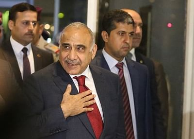 BAGHDAD, Oct. 24, 2018 (Xinhua) -- Adel Abdul Mahdi (Front) arrives at the parliament in Baghdad, Iraq, on Oct. 24, 2018. Adel Abdul Mahdi on Wednesday was sworn in as new prime minister of Iraq after the parliament passed 14 out of his 22 cabinet members. (Xinhua/IANS)