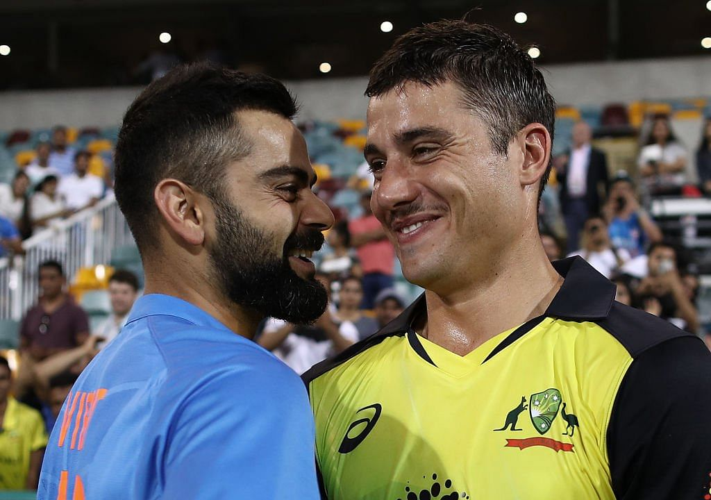 Marcus Stoinis and Virat Kohli share a light moment during India's 2018/19 tour