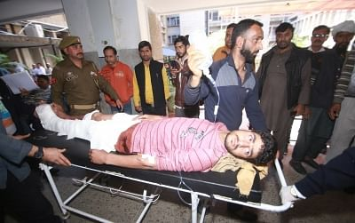 Jammu: One of the 30 persons inured in Jammu bus stand grenade attack being wheeled into a Jammu hospital for treatment on March 7, 2019. One person was killed when a grenade was rolled under a packed parked bus in Jammu