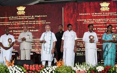 Kancheepuram: Prime Minister Narendra Modi unveils the multiple projects in roadways, railways and energy sector, in Kancheepuram of Tamil Nadu on March 6, 2019. Also seen Tamil Nadu Governor Banwarilal Purohit, Tamil Nadu Chief Minister Edappadi K. Palaniswami, MoS Finance and Shipping P. Radhakrishnan and other dignitaries. (Photo: IANS/PIB)