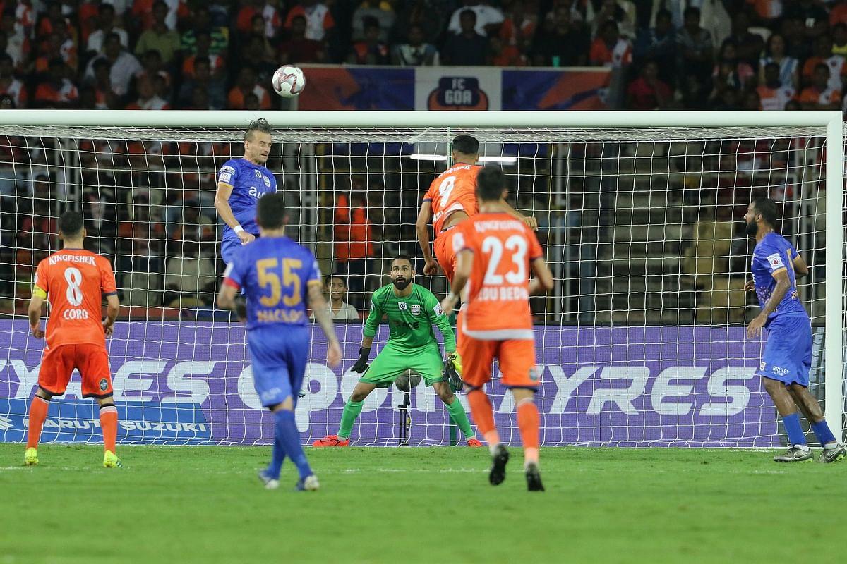 Lucian Goian of Mumbai City FC heads the ball against FC Goa in ISL.