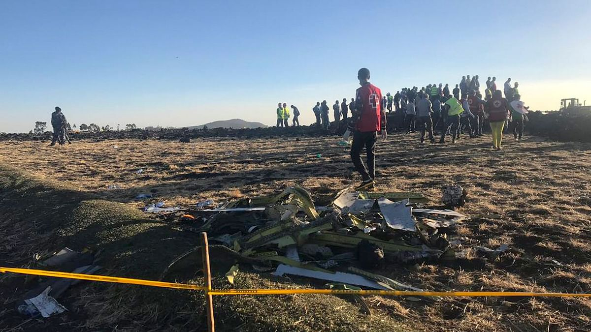 Rescuers search at the scene of an Ethiopian Airlines flight that crashed shortly after takeoff in Ethiopia on Sunday, 10 March.