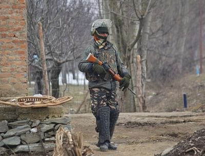 Kupwara: A soldier at the site of an encounter with militants in Jammu and Kashmir