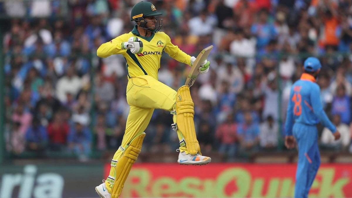 Usman Khawaja celebrates after reaching a 100 during the series-deciding fifth ODI between India and Australia at New Delhi.
