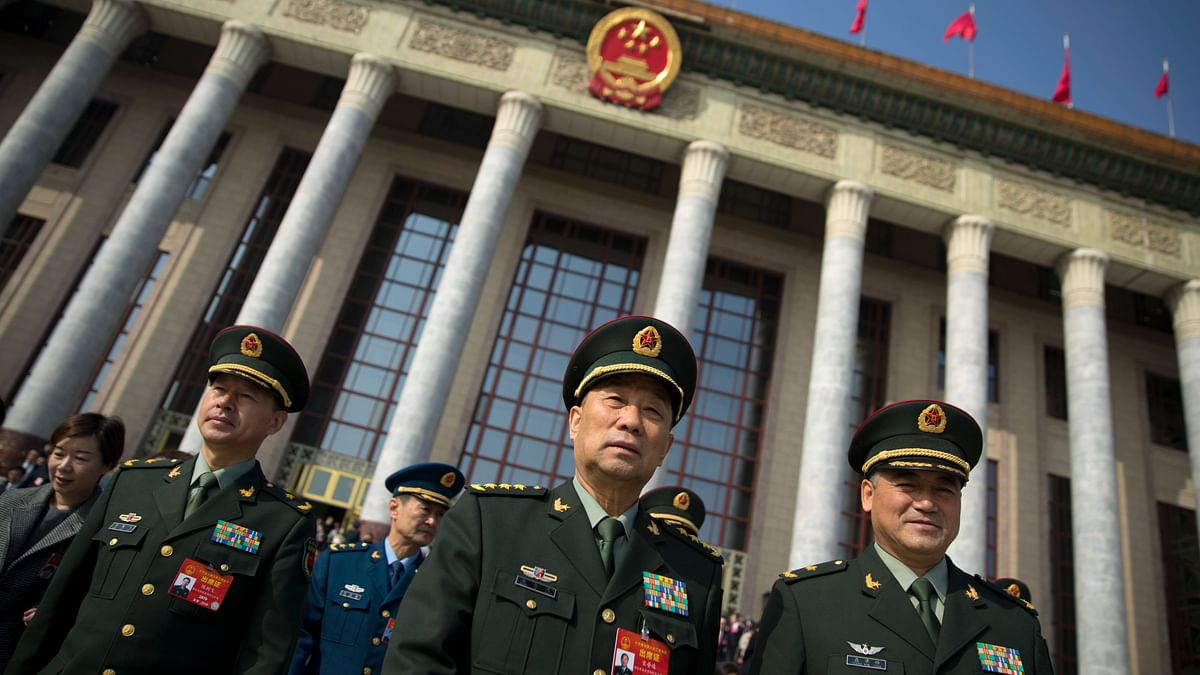 "In this 4 March 2019 photo, military delegates leave after a meeting one day before the opening session of China's National People's Congress (NPC) at the Great Hall of the People in Beijing. To a remarkable degree, the Pentagon's new budget proposal is shaped by national security threats that Acting Defense Secretary Patrick Shanahan has summarized in three words: ""China, China, China."""