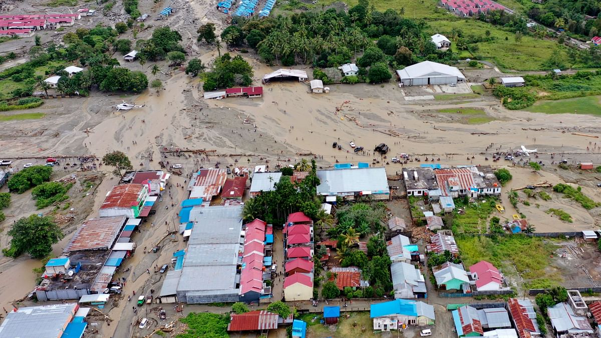 This aerial shot taken on Sunday, 17 March, 2019 shows the area affected by flash floods in Sentani, Papua province, Indonesia. Flash floods and mudslides triggered by downpours tore through mountainside villages in Indonesia's easternmost province, killing dozens of people, disaster officials said.