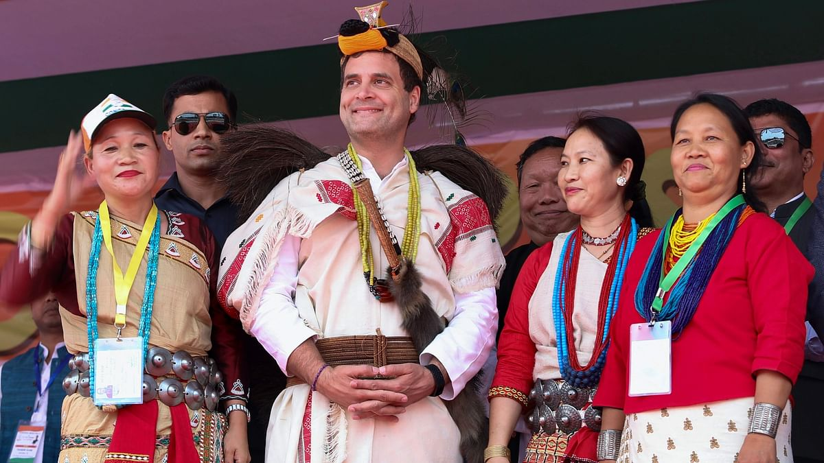 Congress President Rahul Gandhi with party supporters during a public meeting, in Itanagar.