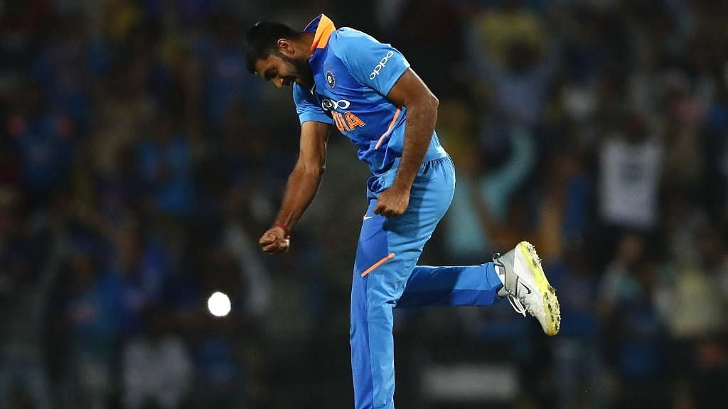 Vijay Shankar celebrates after taking the decisive last wicket in India's eight-run win in the second ODI against Australia at Nagpur.