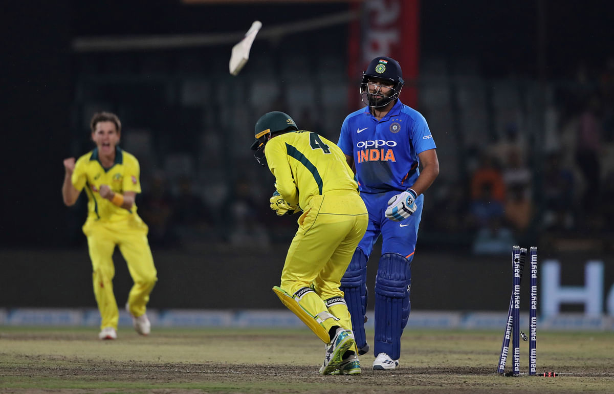 Rohit Sharma top-scored with 56 as India fell short by 35 runs in their series-deciding fifth ODI against Australia at New Delhi.