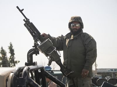 NANGARHAR, March 6, 2019 (Xinhua) -- An Afghan security force member stands on a military vehicle near the site of an attack in Nangarhar province, Afghanistan, March 6, 2019. A total of 21 people including five attackers were killed and nine others injured as a blast followed by gun shots rocked Jalalabad city, the capital of eastern Nangarhar province on Wednesday, provincial government spokesman Attaullah Khogiani said. (Xinhua/Saifurahman Safi/IANS)