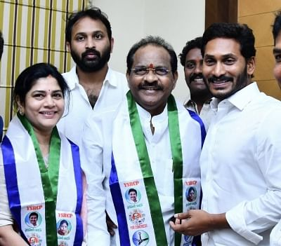 Hyderabad: TDP MP Thota Narasimham and his wife Vani join YSR Congress Party in the presence of party president Y. S. Jaganmohan Reddy in Hyderabad on March 13, 2019. (Photo: IANS)