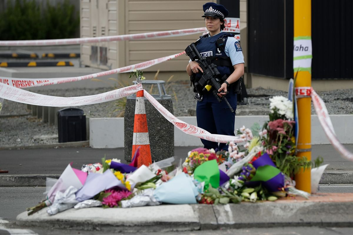 Police stand by makeshift memorial near the Linwood Mosque in Christchurch, New Zealand, Saturday, 16 March 2019, where one of the two mass shootings occurred.