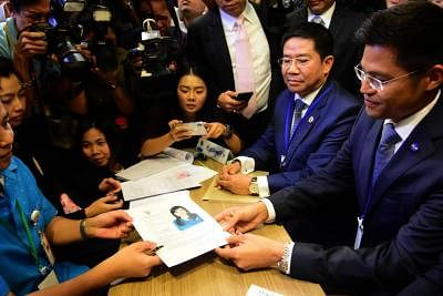BANGKOK, Feb. 8, 2019 (Xinhua) -- Thai Raksa Chart party leader Preechapol Pongpanich (R) holds the registration document of Princess Ubolratana Mahidol in Bangkok, Thailand, Feb. 8, 2019. Thai Raksa Chart party on Friday nominated Princess Ubolratana Mahidol as their candidate for prime minister. (Xinhua/IANS)