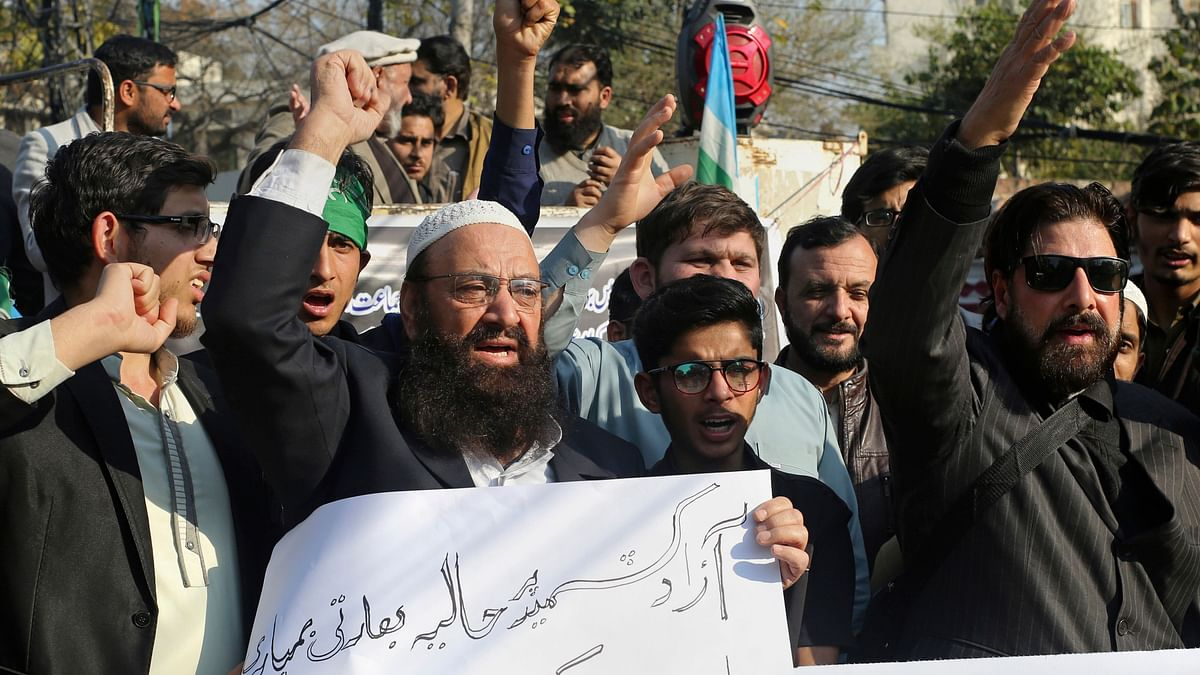 "Supporters of Jamaat-e-Islami attend anti-India rally, with one holding a poster that reads, ""we condemn the Indian attack,"" in Lahore on 26 Feb 2019. Image used for representational purposes."