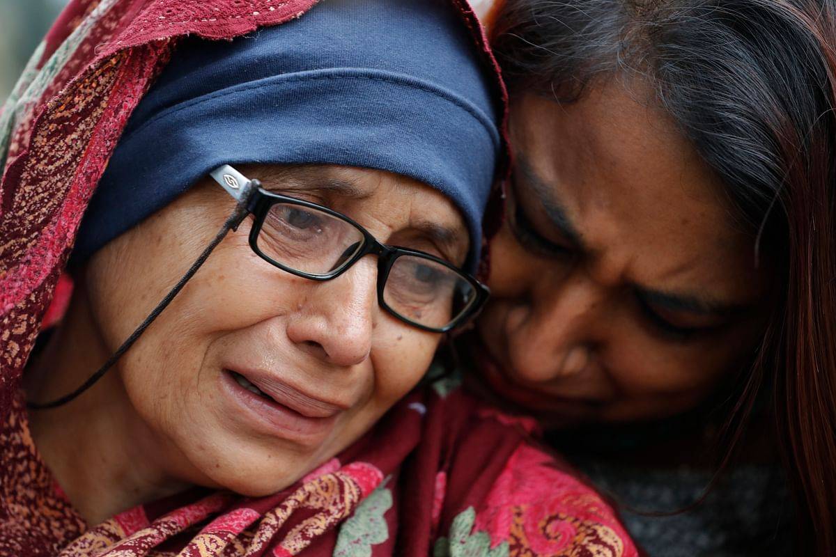 A woman who lost her husband during Friday's mass shootings cries outside an information center for families, Saturday, 16 March 2019, in Christchurch, New Zealand. The white supremacist gunman appeared in court Saturday charged with murder in the mosque assaults that killed at least 49 people and led to the prime minister to call for a tightening of national gun laws.