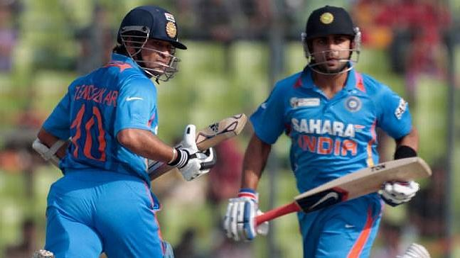 File picture of Sachin Tendulkar (left) and Virat Kohli batting at the crease together.