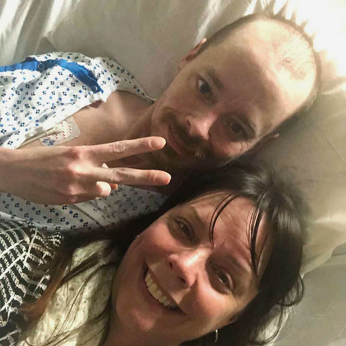 Bridgette Hoskie and her brother Jay Barrett  pose for the photo inside an ICU at Yale New Haven Hospital in New Haven, Connecticut on 26 February, 2019.