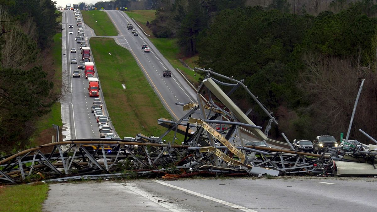 A fallen cell tower lies across US Route 280 highway in Lee County, Alabama, in the Smiths Station community.