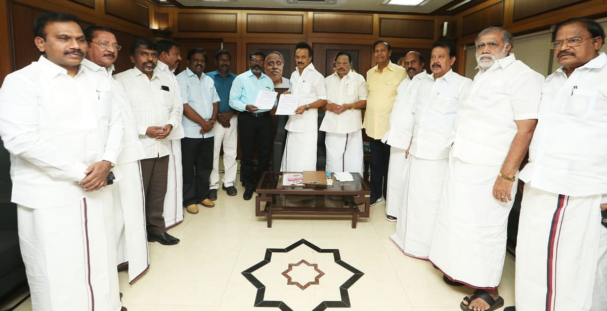 VCK's Thirumavalavan signs seat-sharing pact with DMK's MK Stalin.