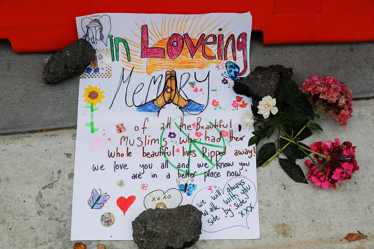 A message is displayed at a makeshift memorial outside Christchurch hospital in Christchurch, New Zealand, Saturday, 16 March 2019, one day after the mass shootings at two mosques in the city.