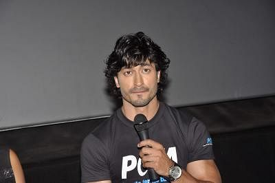Bollywood actor Vidyut Jammwal poses during the unveiling of PETA (People for Ethical Treatment of Animals), new pro veg ad at PVR in Mumbai on April 11, 2013. (Photo: IANS)