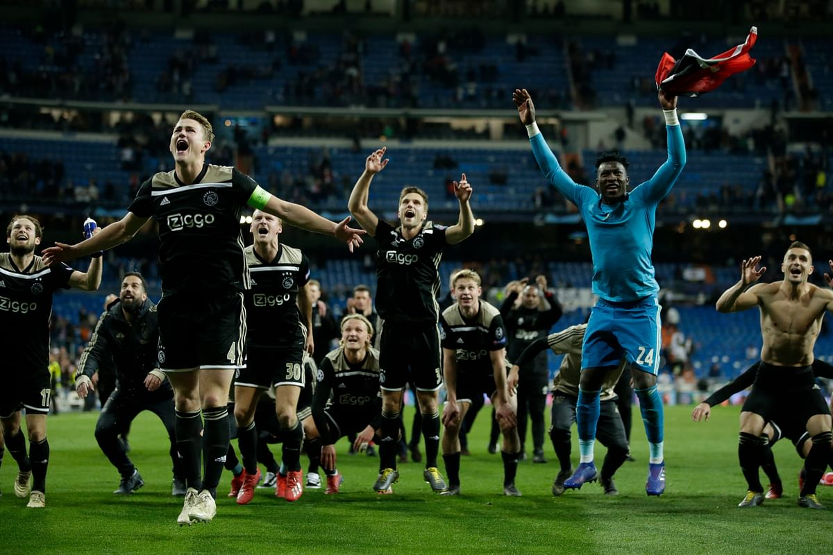 Ajax players celebrate after the Champions League round of 16 second leg soccer match between Real Madrid and Ajax at the Santiago Bernabeu stadium in Madrid, Tuesday, March 5, 2019. Ajax won 4-1.