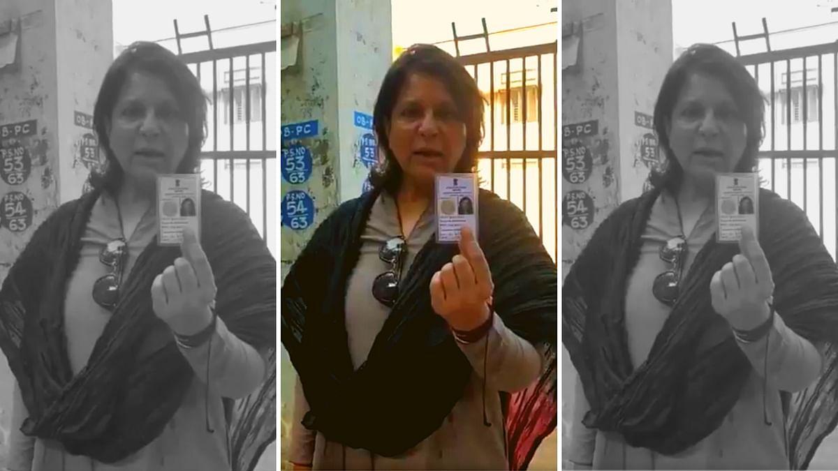 Shobhana Kamineni holds up her voter ID card.
