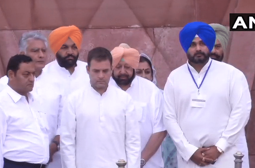 Congress President Rahul Gandhi (centre) along with CM Amarinder Singh (second from right) and Congress leader Navjot Singh Sidhu (right) pays his respects to those killed in the massacre, 100 years ago.