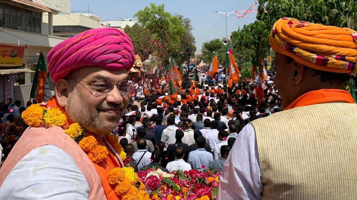 Amit Shah took out a massive roadshow on his way to file nomination for the Gandhinagar Lok Sabha Seat on 30 March 2019.