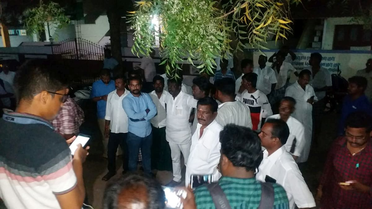 DMK supporters stands in front of DMK leader Kanimozhi's house were income tax department raided the house of DMK leader Kanimozhi in Tamil Nadu's in Tuticorin on Tuesday, 16 April.