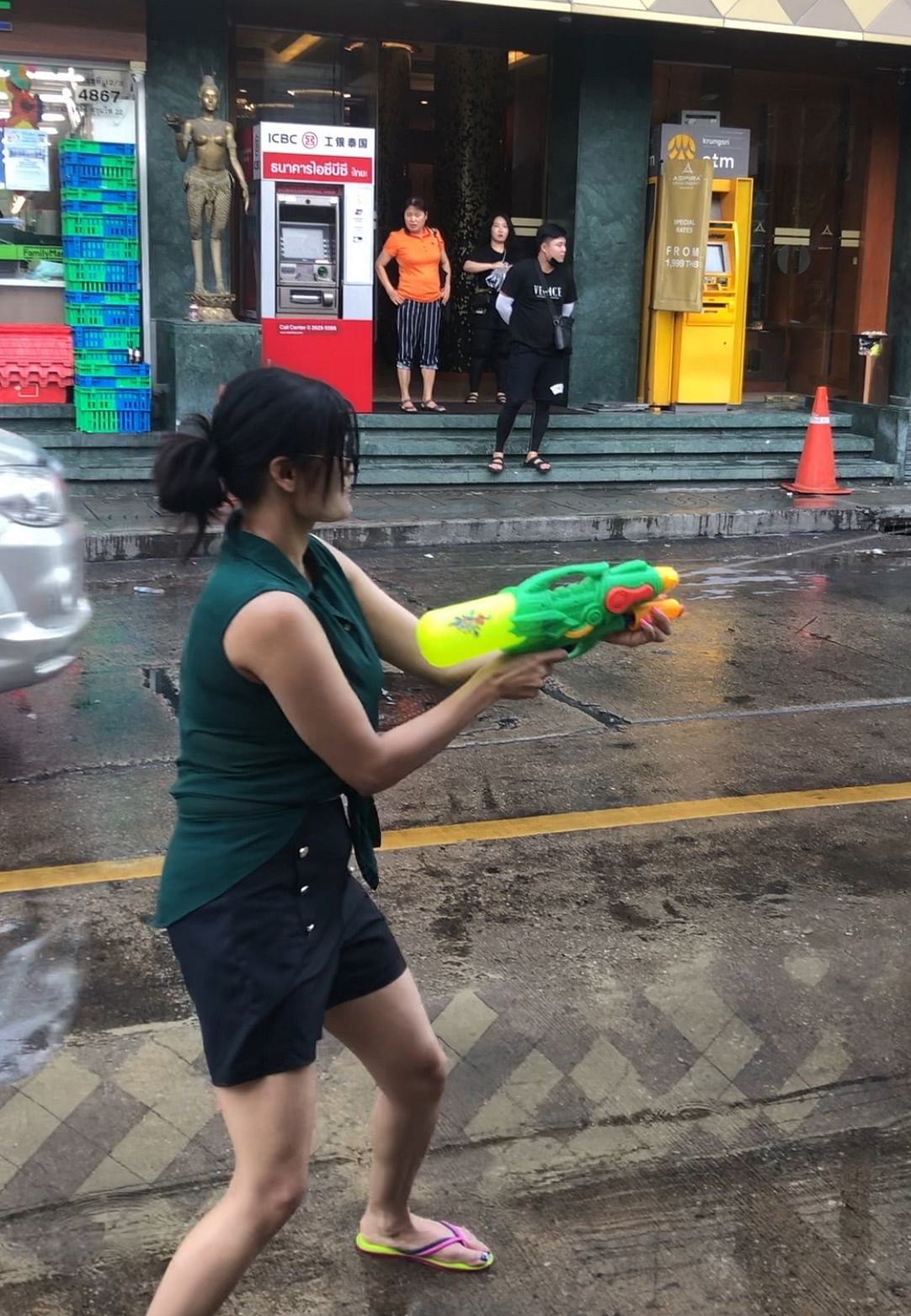 Author celebrating the Songkran festival on the streets of Bangkok by training her water gun on fellow revellers.
