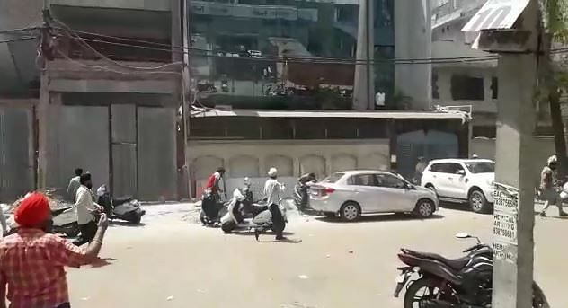 Residents chase after the forces.