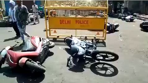 Toppled two-wheelers in the violence.