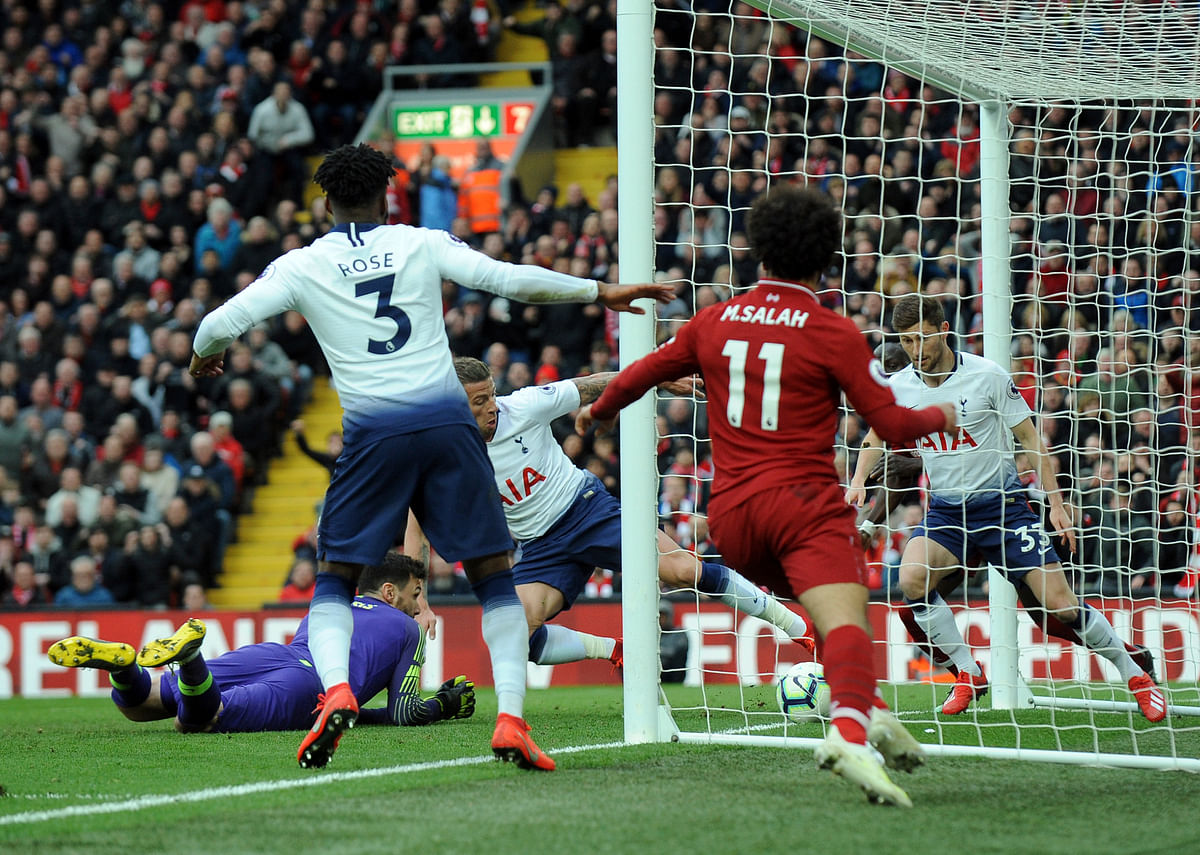 Tottenham's Toby Alderweireld, center, scores an own goal past his goalkeeper during the English Premier League soccer match.