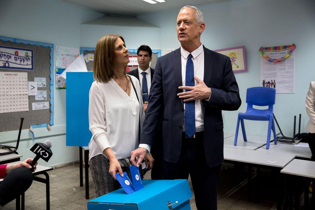 Netanyahu's main challenger Benny Gantz casts his vote along with wife Revital Gantz