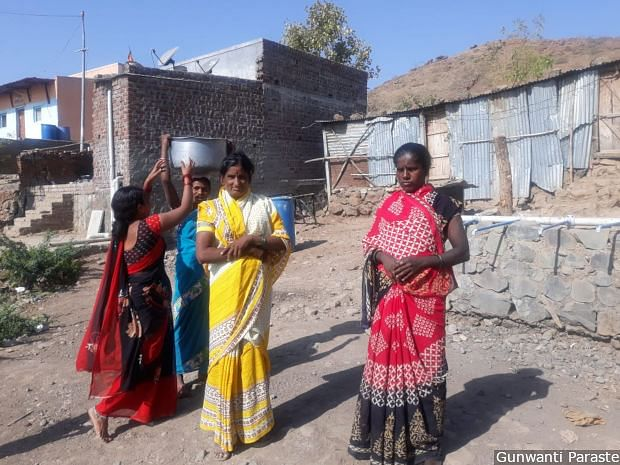 Forty-year-old Shindubai Upekar (in yellow) of Uttamnagar, a village near Dahiwandi, walks 5 km every day to collect drinking water. The taps seen in the background are connected to a community well constructed by the Dahiwandi gram panchayat.