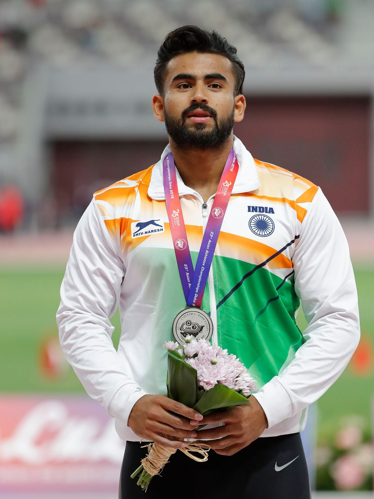 Shivpal Singh celebrates after winning the silver medal for the men's javelin throw.