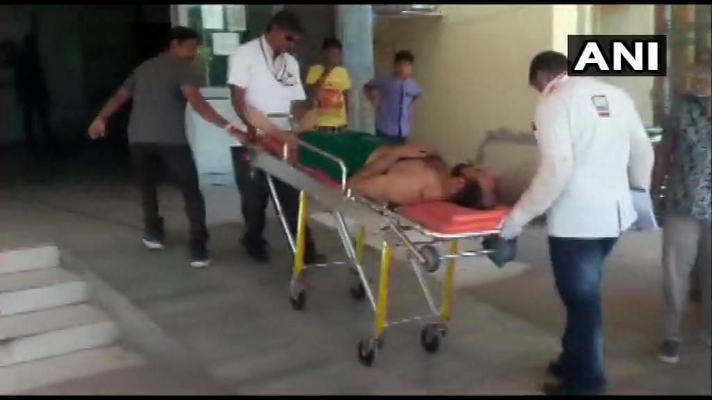 The assailant being wheeled into a hospital following injuries.