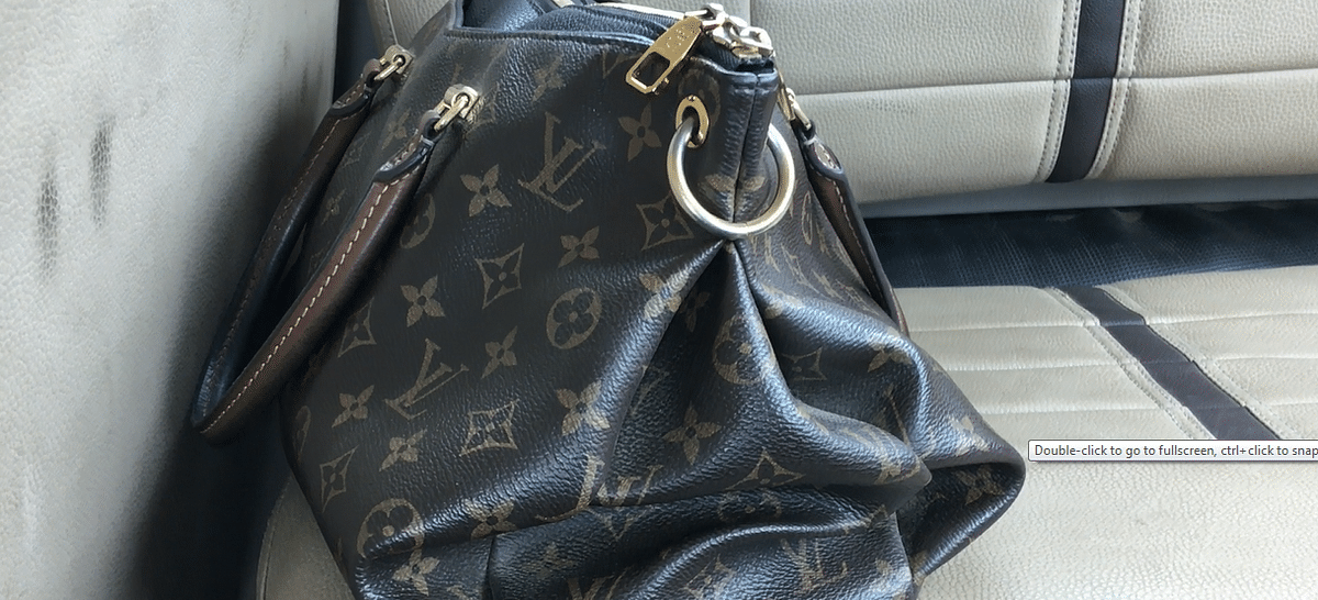 Inspite of my attempts at keeping this interview strictly feminist, I couldn't help sneak a picture of the famed Louis Vuitton bag which sat pretty in the back seat of her car.