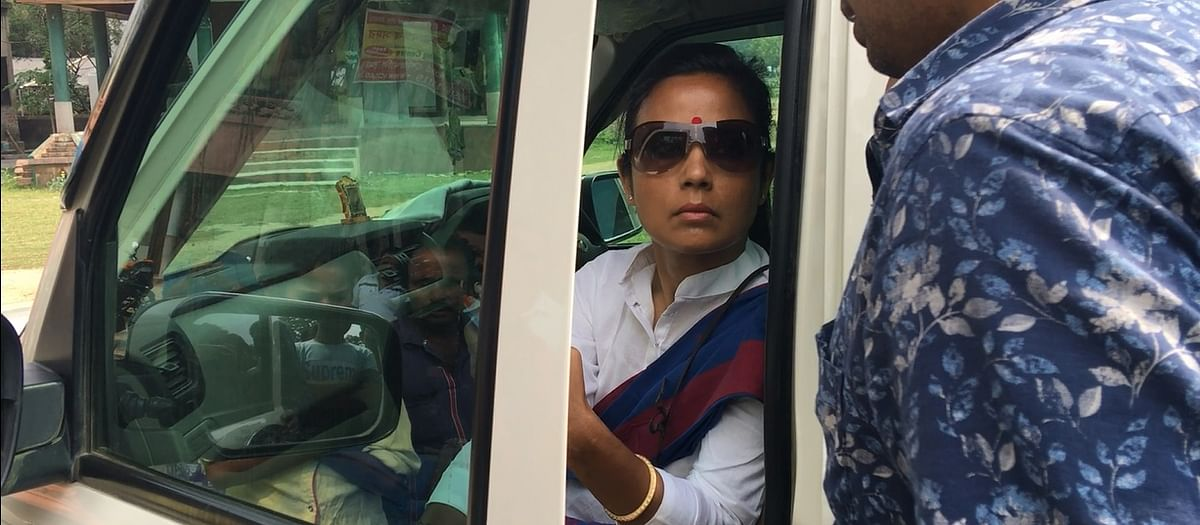 Mahua waits in the car while mobilising her cadre.