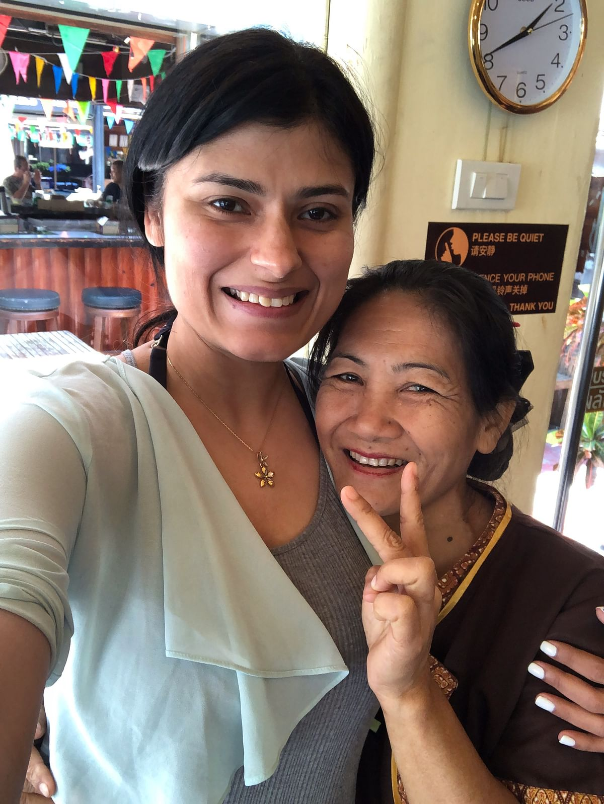Author with the Thai masseuse that kneaded the fatigue out of her body in less than an hour.