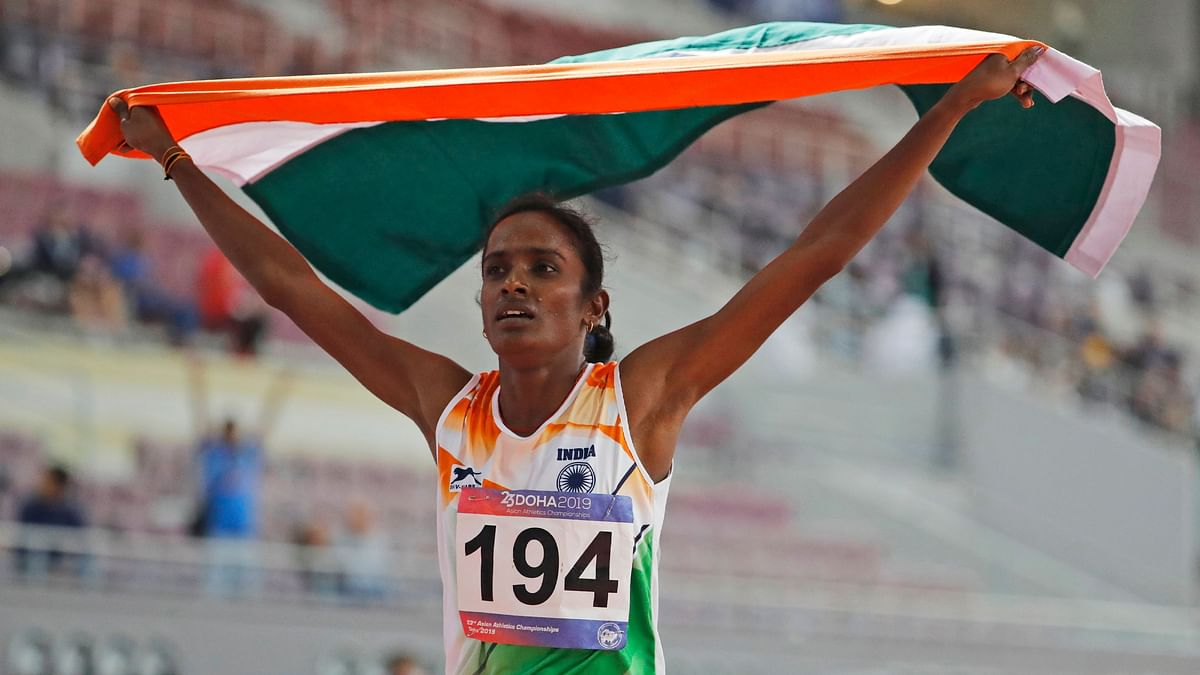Gomathi Marimuthu celebrates after winning gold in the women's 800-meters final race at the Asian Athletics Championships in Doha.