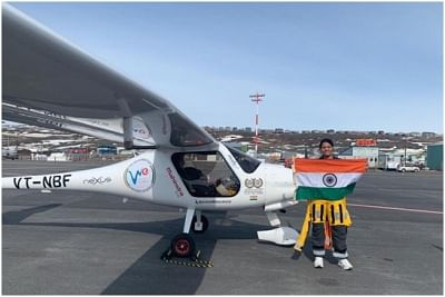 Mumbai: Captain Aarohi Pandit poses with the Indian flag after landing in Canada on May 14, 2019. Captain Aarohi Pandit, a 23-year-old pilot from Mumbai became the world