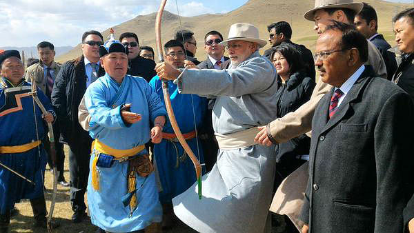 Modi in Mongolia in 2017: PM Modi tries his hand at archery at the Mini-Naadam Festival in Mongolia.
