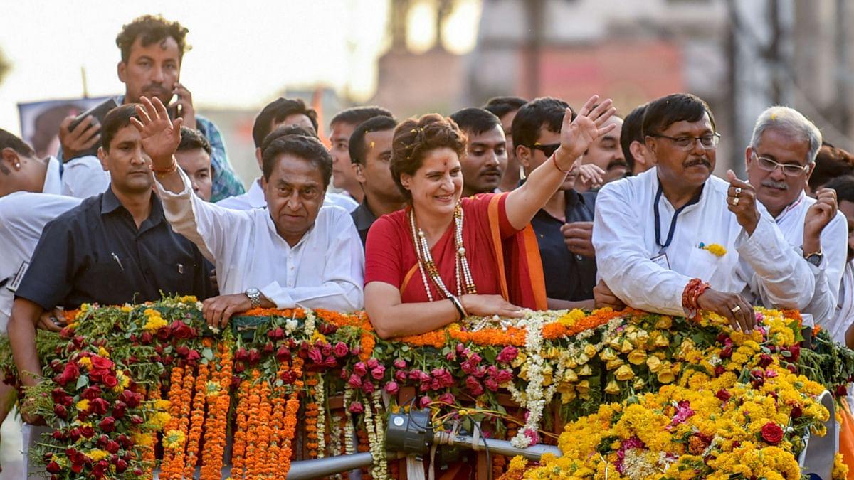 Congress General Secretary Priyanka Gandhi Vadra with Madhya Pradesh Chief Minister Kamal Nath during a roadshow in Indore.