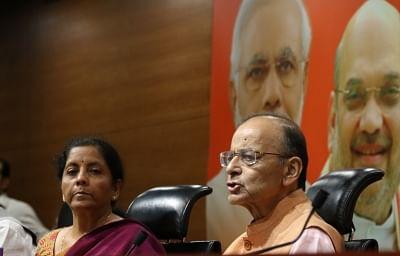 New Delhi: Arun Jaitley and Nirmala Sitharaman address a press conference at the BJP HQ