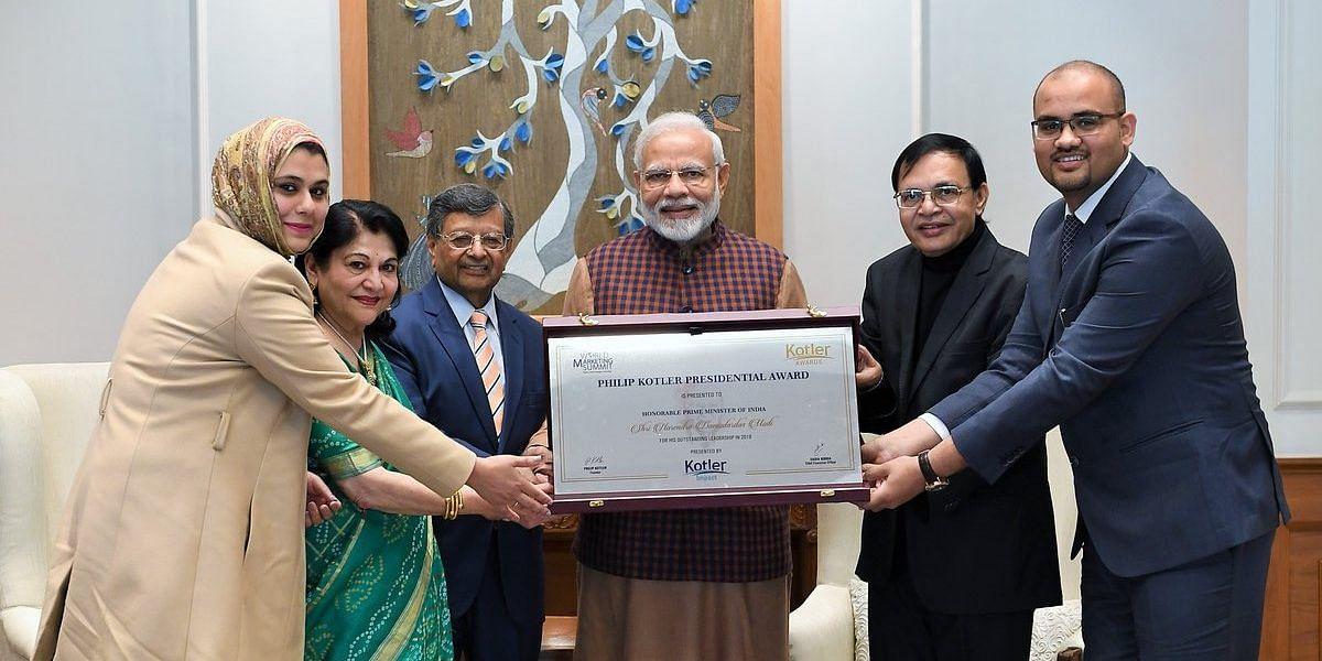 Prime Minister Narendra Modi receives the Kotler Presidential Award from the World Marketing Summit.