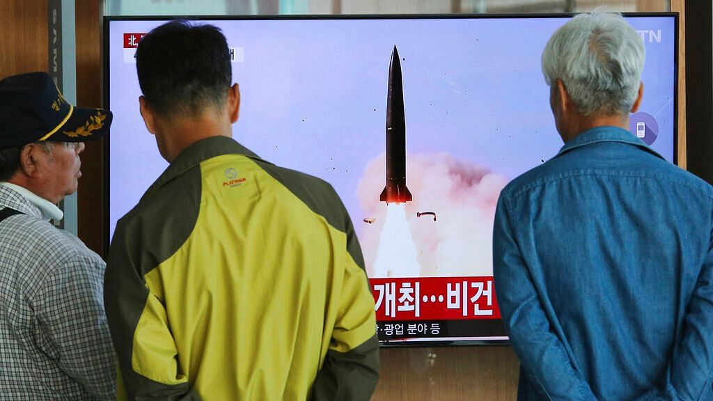 People watch a TV showing a file photo of North Korea's weapon systems during a news program at the Seoul Railway Station on Thursday, 9 May.