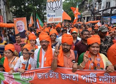 Kolkata: BJP supporters participate in party chief Amit Shah